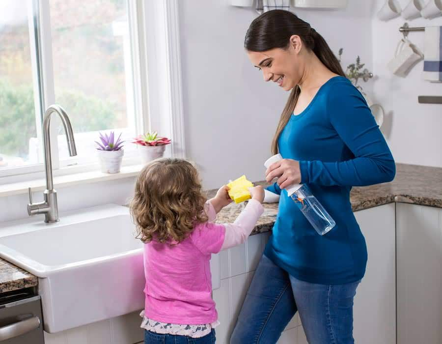 Woman and child cleaning with Force of Nature